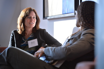 Sarah Efthymiou consults with Even Runyon of Corporate P