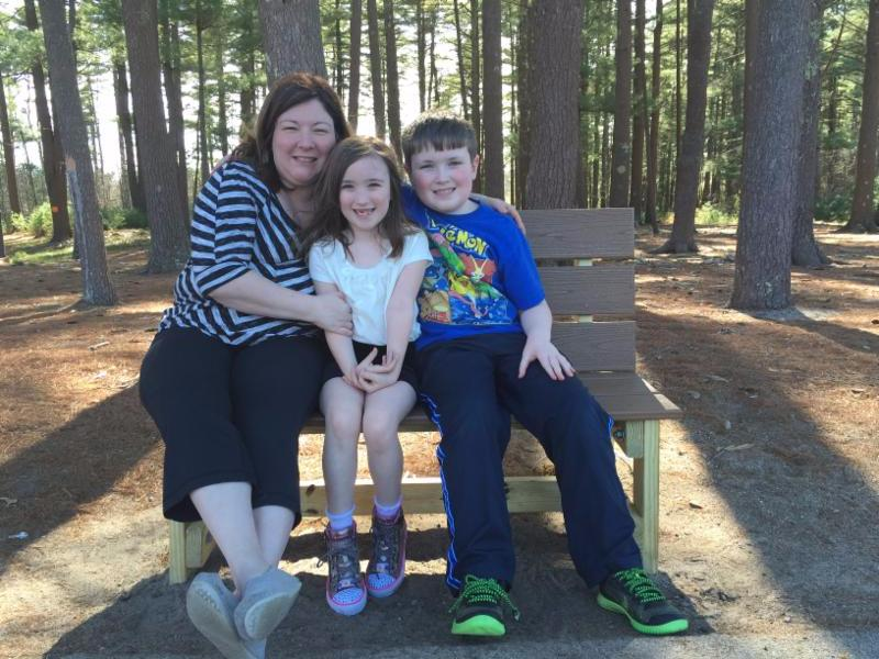 Brenda Preston and her children who attend Carver Elementary___. ___Brenda was instrumental in bringing a Buddy bench to Carver.