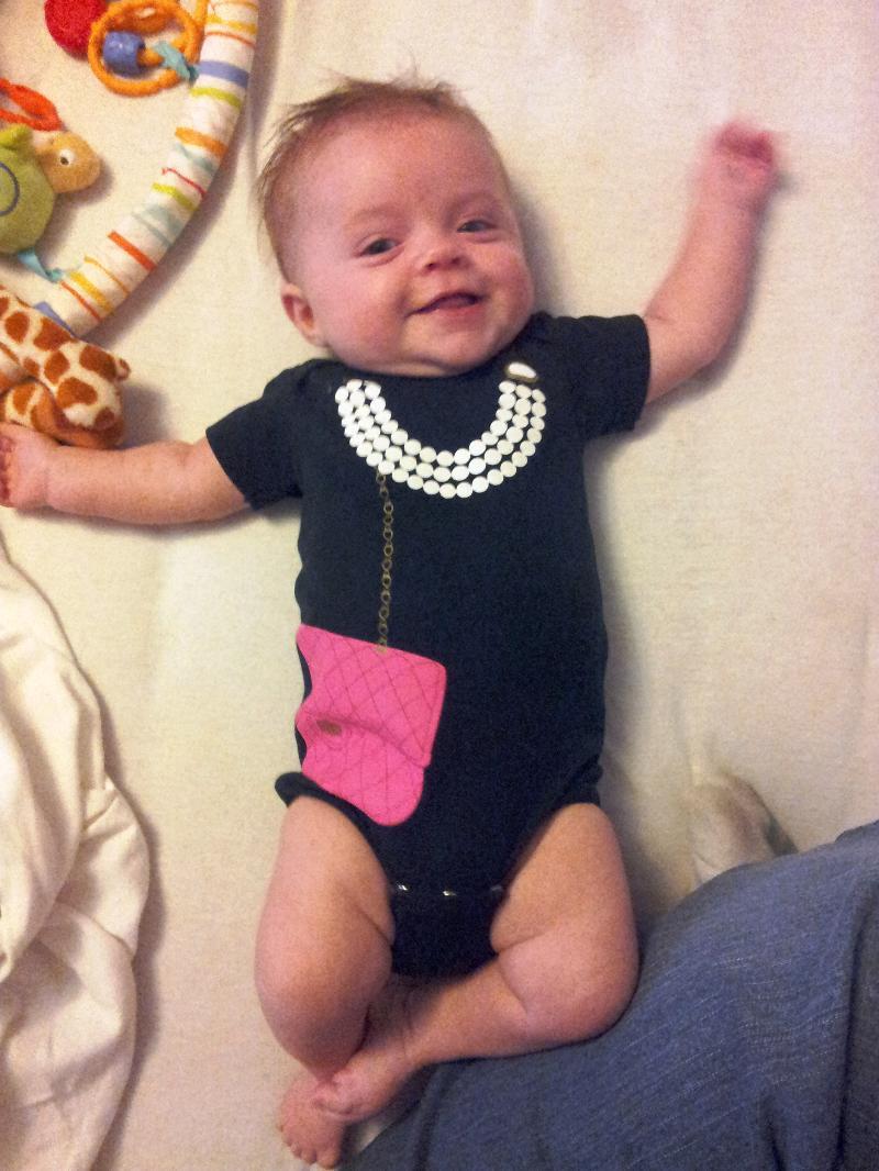 Dressed up in pearls & purse black onsie
