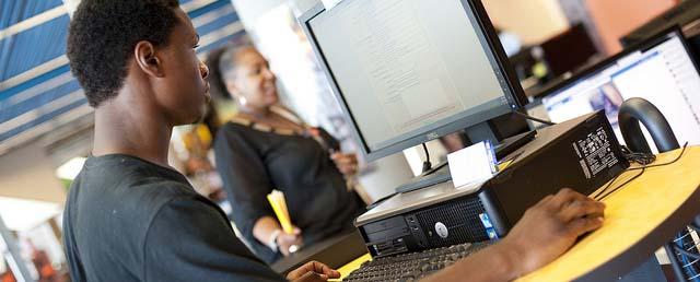 teen using computer at ImaginOn