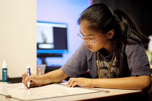 Teen working on project in ImaginOn