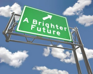 A Brighter Future road sign with blue sky background with puffy white clouds