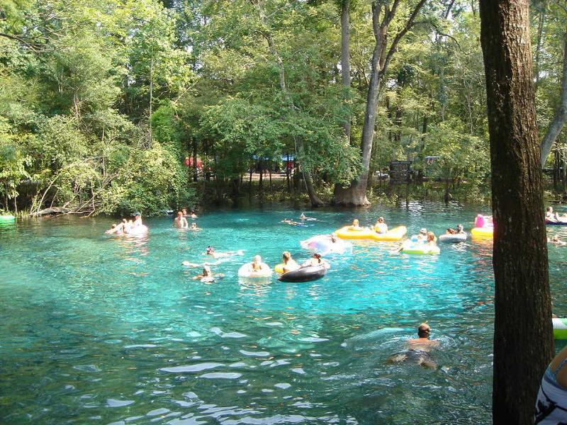 People Enjoy the cool waters of Ginnie Springs in High Springs Florida