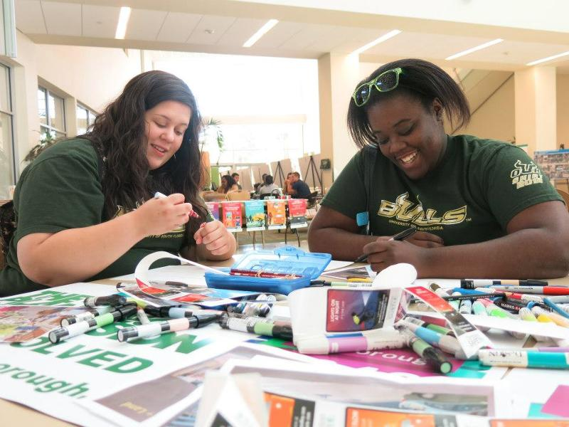 USF students drawing their vision of a complete street.