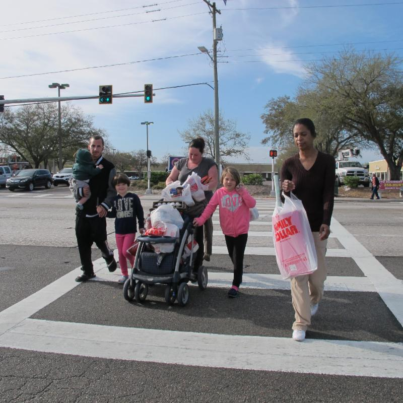 Families use the new signaled crosswalk at E. Hillsborough Ave. and Meridian Apartments