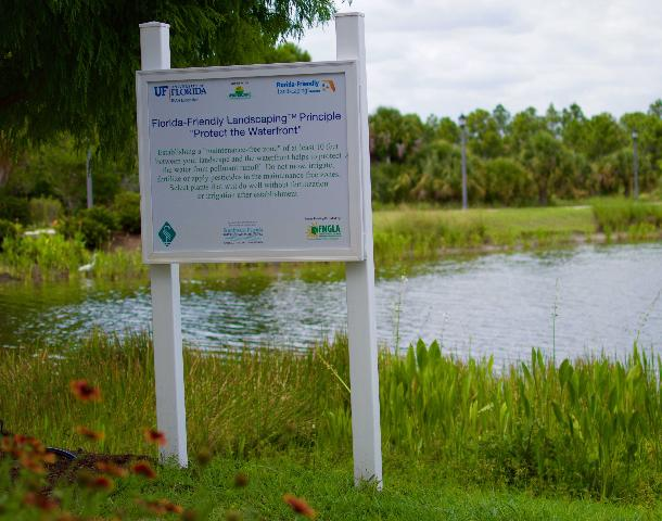 A sign near Lakewood Ranch Town Hall on Lake Uihlein describes the Florida-Friendly Landscaping_ Principle Protect the Waterfront