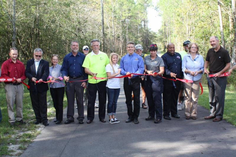 Local officials and stakeholders join in the ribbon cutting for the newest section of the Upper Tampa Bay Tail