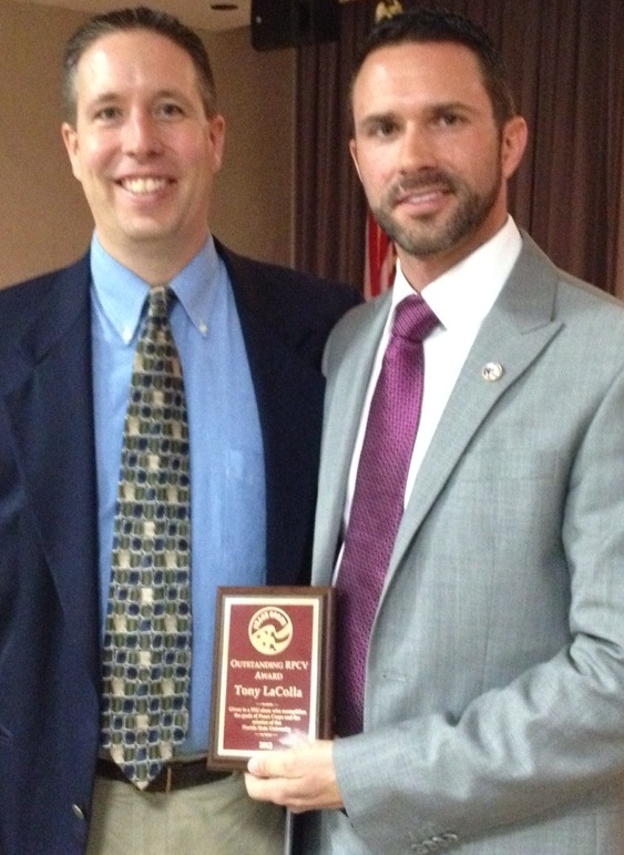Tony LaColla receiving FSU Alumni honor from FSU Department of Urban and Regional Planning Chairman Dr Tim Chapin