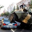 Tank Crushes Car Blocking Bike Lane