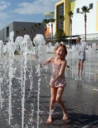 Splashing in fountains at Curtis Hixon Park