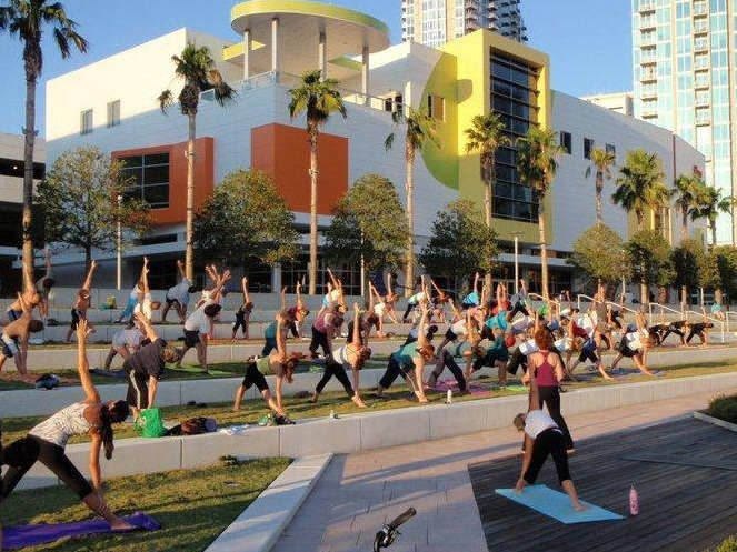 Yoga Tampa Bay in Curtis Hixon Park with Glazer Children's Museum in background