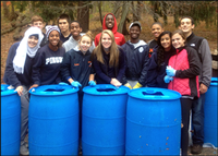 Pingry School students pose with rain barrels they constructed.