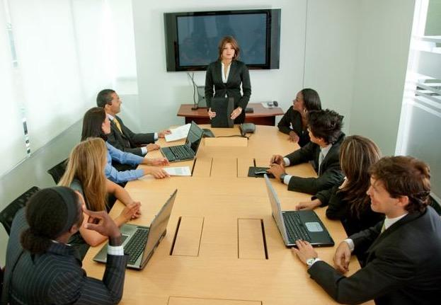 Group of business people at a staff meeting
