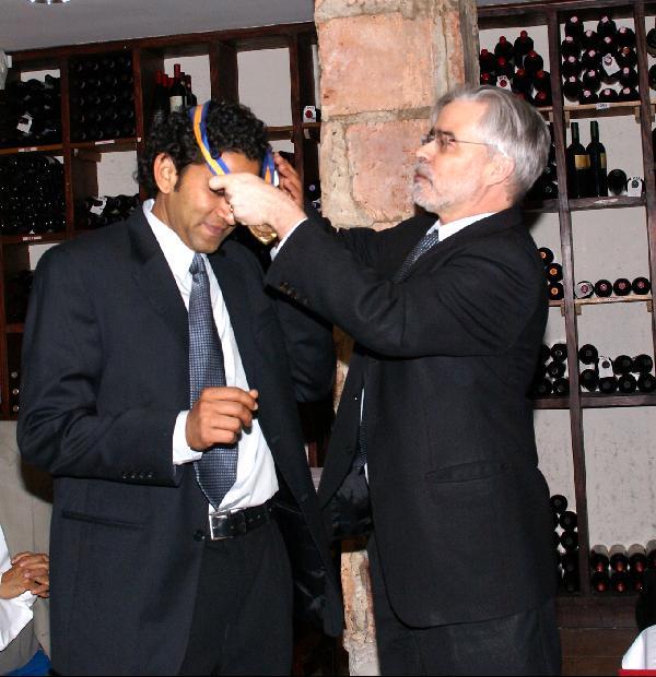 President Heath awarding medal to Dr. Miduturu Srinivas