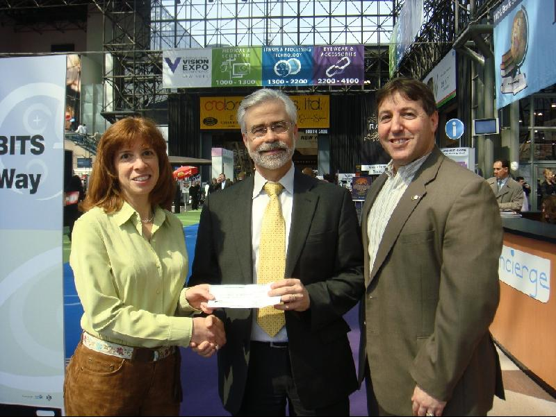 Presentation of NJ Chapter of AAO Check to President Heath by Dr. Maria Richman and Dr. Harvey Richman
