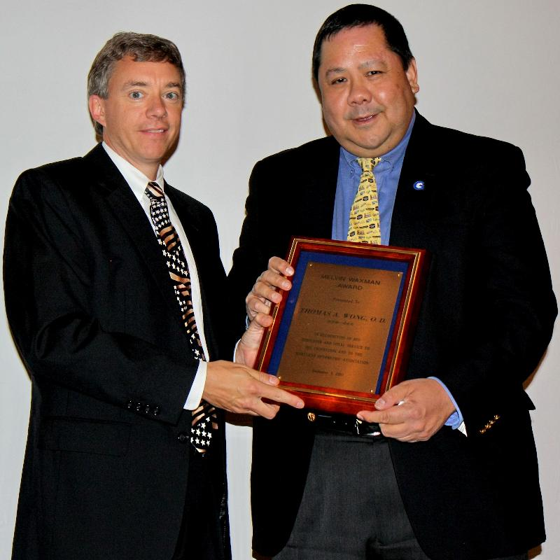 Dr. Wong receives award from Dr. Burns