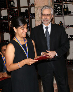 Ms. Soriano receives award from President Heath