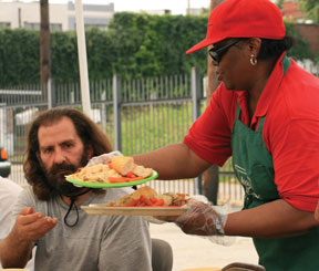 Martie serving to one of our homeless guests
