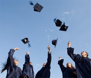 Graduates throw caps in the air