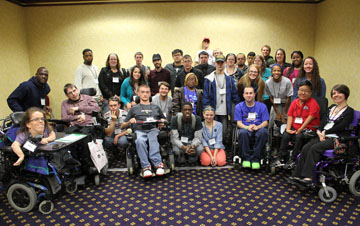 A diverse group of youth gather for a photo at the APRIL Youth Conference