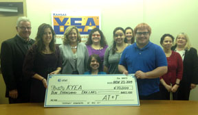 KYEA staff and supporters with AT&T check