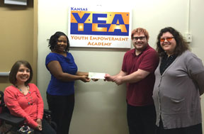 KYEA staff and Maximus rep with grant check