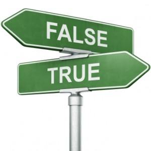 Road signs, pointing in opposite directions, that say true and false