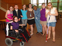 Youth with various disabilities hang out and pose for photo with their arms around each other