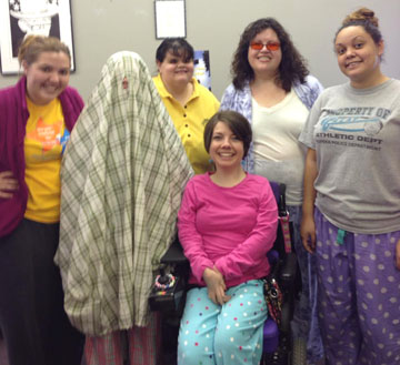 KYEA staff in their pajamas on Halloween