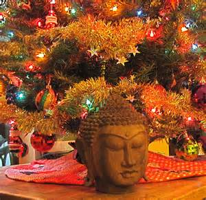 lit up tree with Buddha statue in front