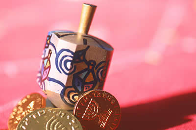 dreidel and coins
