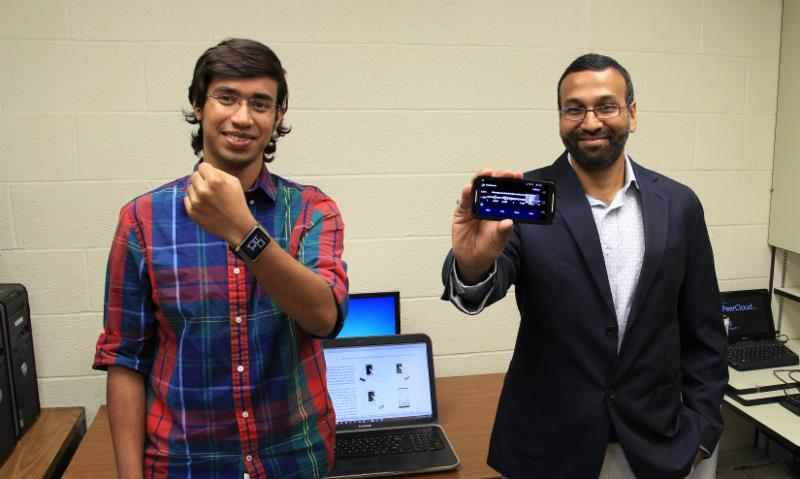 Grad student Anindya Maiti, left, and assistant professor Murtuza Jadliwala are working together with other students and professors on a project studying the security of wearable devices. The project is funded by the National Science Foundation.