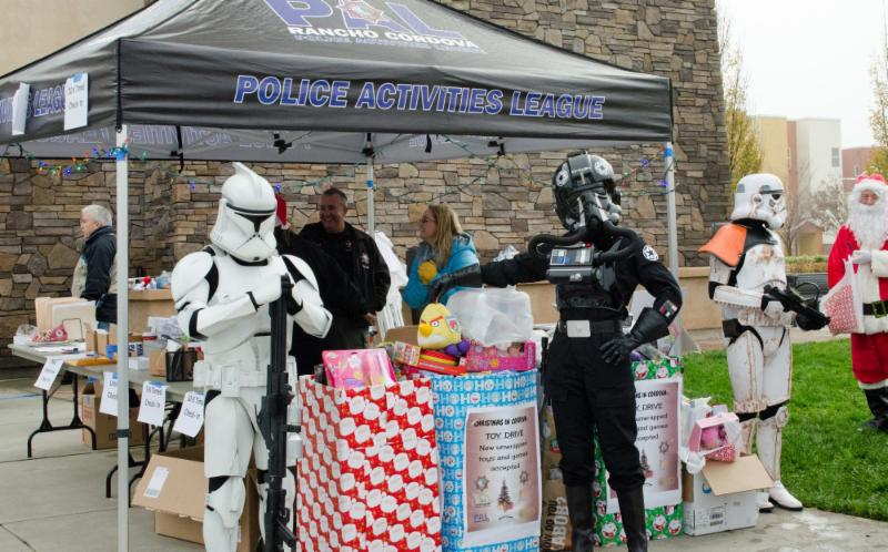 Photo of Star Wars characters from the 501st Legion_ Central California Garrison collecting toys.