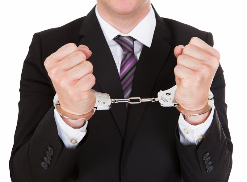 Portrait of criminal businessman isolated over white background
