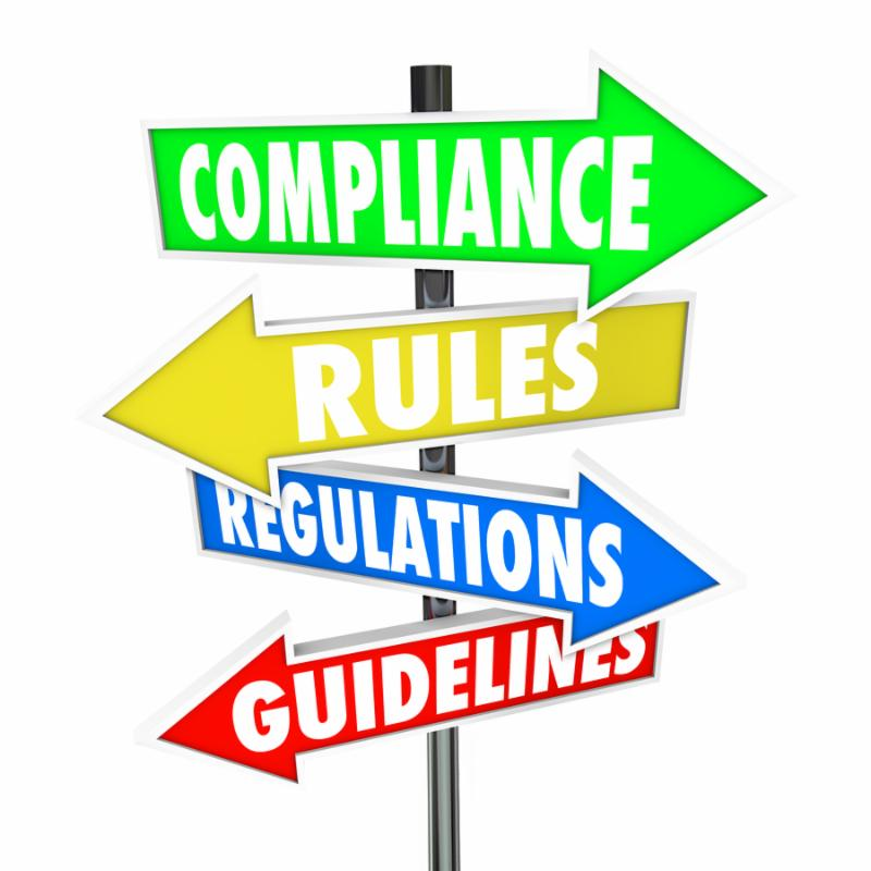 The words Compliance, Rules, Regulations and Guidelines on colorful arrow road signs directing you
