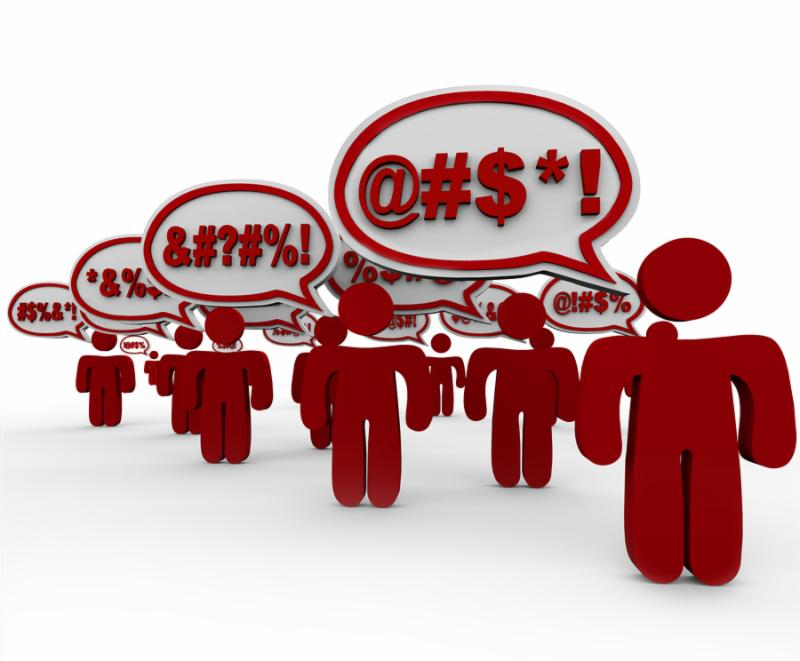 An angry mob of people swears bad words in speech clouds or bubbles to voice their anger, frustrations and complaints using cussing, swearing and vulgarity