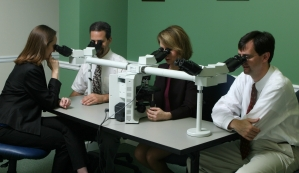 Pathologists at the teaching microscope