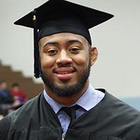 young man in graduation robe _ hat
