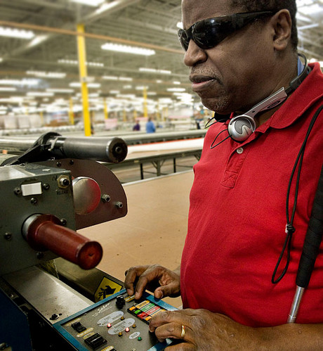 blind man operating a machine