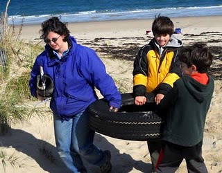 Belinda and kids picking up tire