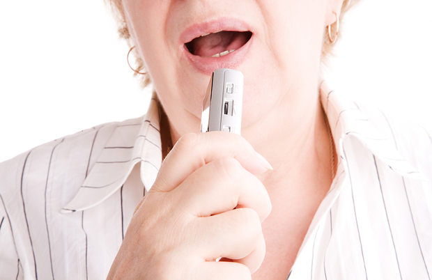 woman dictating into recorder