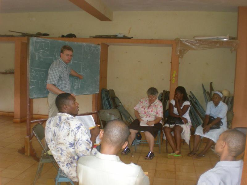 Dr. Fredrick training health workers