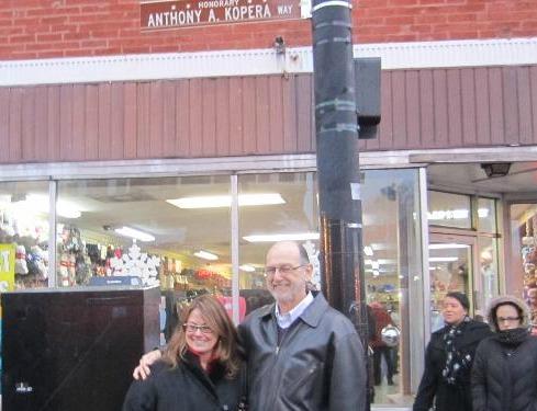 Tony's family by new street sign