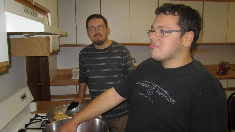 young adults at stove