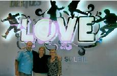 Barbara in front of Love sign