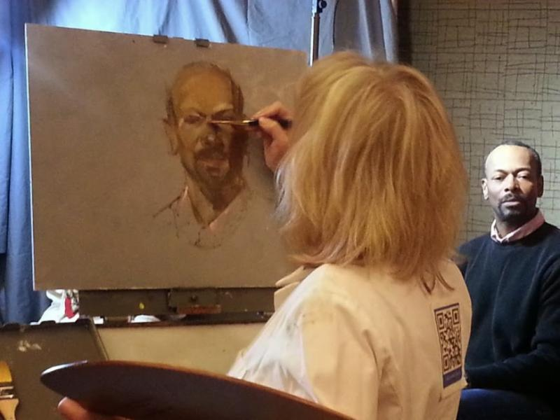Artist Chris Saper painting at the 2014 Portrait Society of America