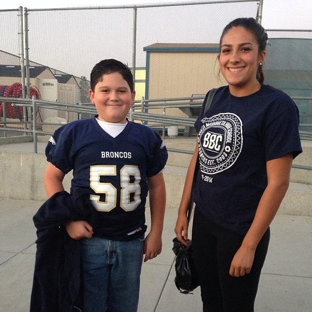 Jacob wearing a football jersey.