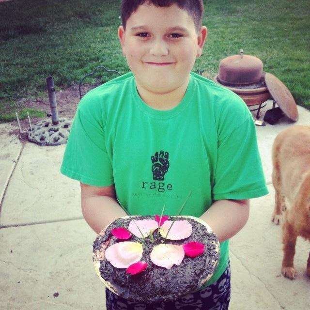 Jacob holding a mud pie.