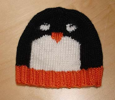 This penguin hat is knit flat and sewn. If you have a fear ...