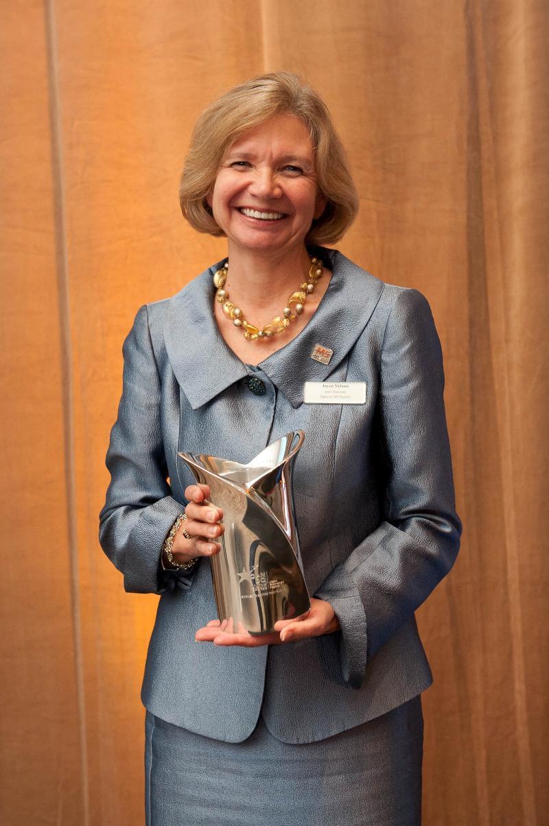 Joyce Nelson receiving Can Do Award